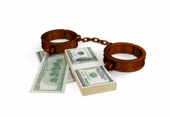12217866 - shackles and dollar pack. 3d rendered. isolated on white background.