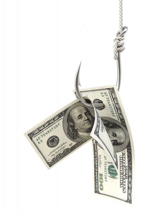 21889531 - dollar bills on a fishing hook. isolated on white.